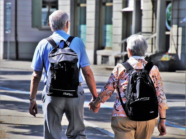 image of senior couple holding hands representing care home
