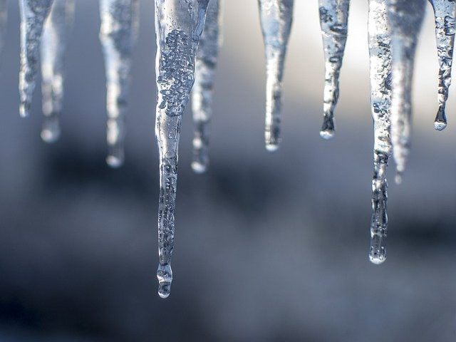 Image of icicles representing extreme weather perfect for business door installation