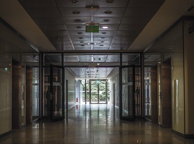 image of an open floor that represent installing sliding doors in your business