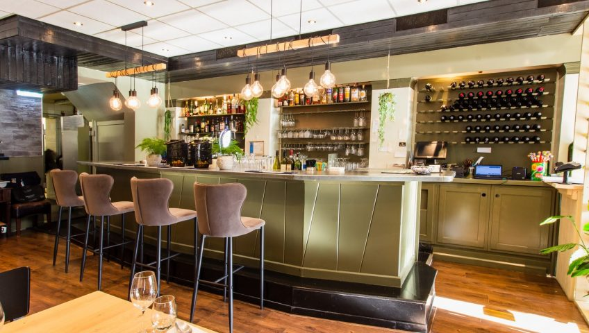 safe kitchen environment for staff, barstools kept across the counter