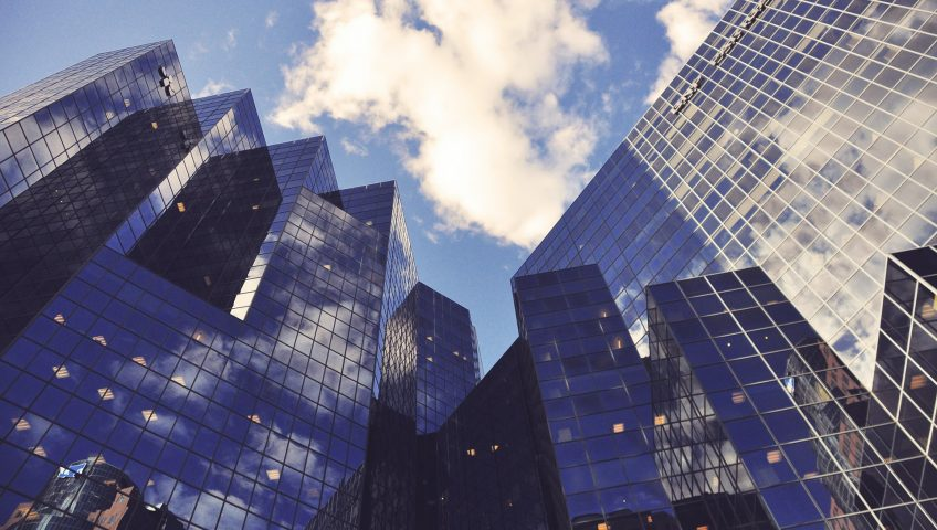 Assess security risks in your business, high-rise buildings with white clouds in the backdrop