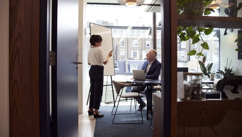 Automatic doors vs Manual doors; an open wooden door in an office showing two people having a discussion