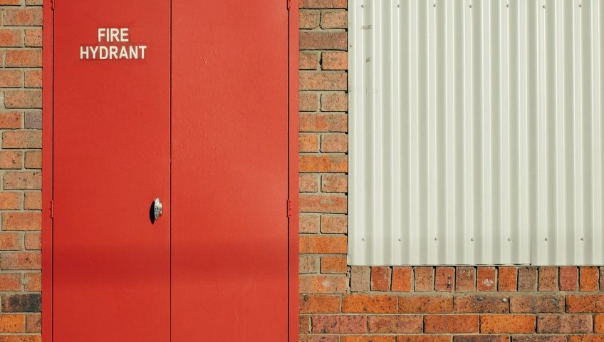 Fire Doors for Business; Red coloured fire door installed with 'Fire Hydrant' written on it