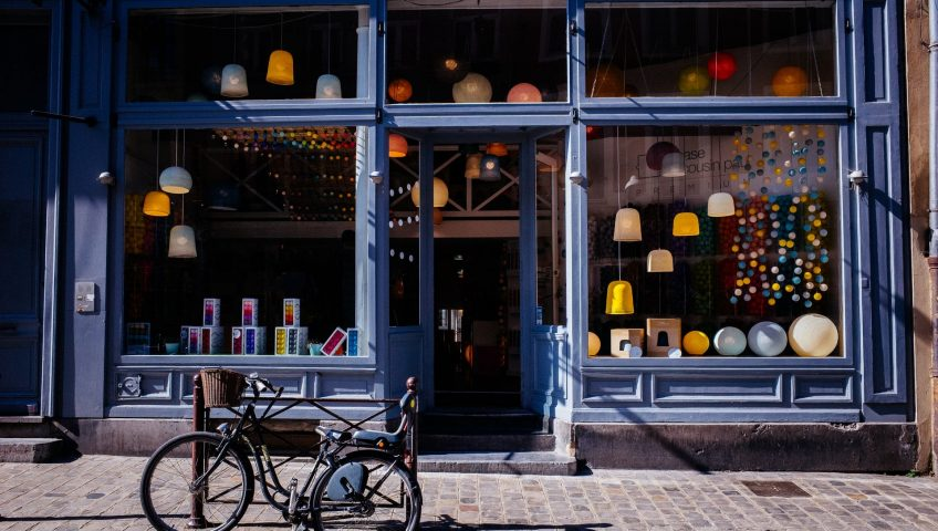 Shop maintenance tips; a blue shop entrance with different types of lights as the window display