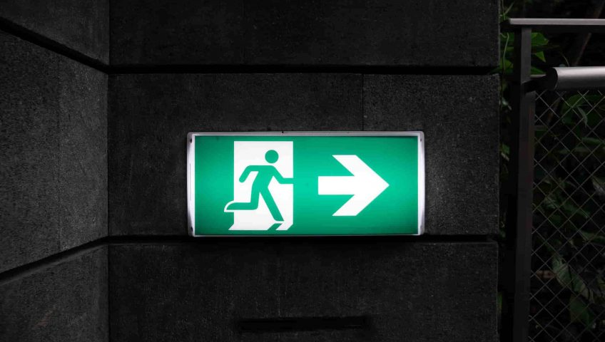 Fire Exit Regulations; a fire exit sign in green