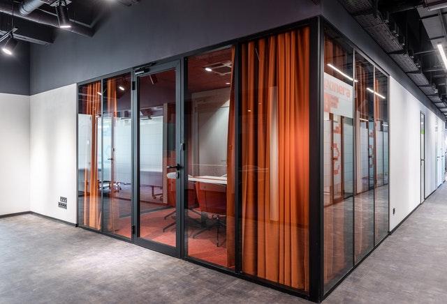 Benefits steel doors; stylish black steel doors in a modern office